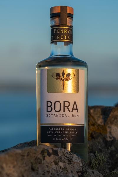 BORA rum sitting on rocks in sunrise